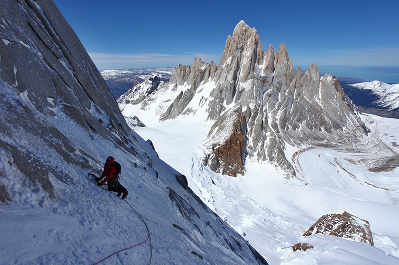 Will Sim making a calf burning traverse with the Fitz Roy massif in the distance, 148 kb