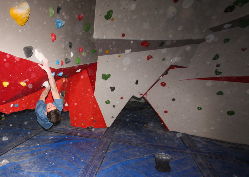 Sean Hopkins, Climbing Hangar staff member, tests the crux problem on the white circuit., 120 kb