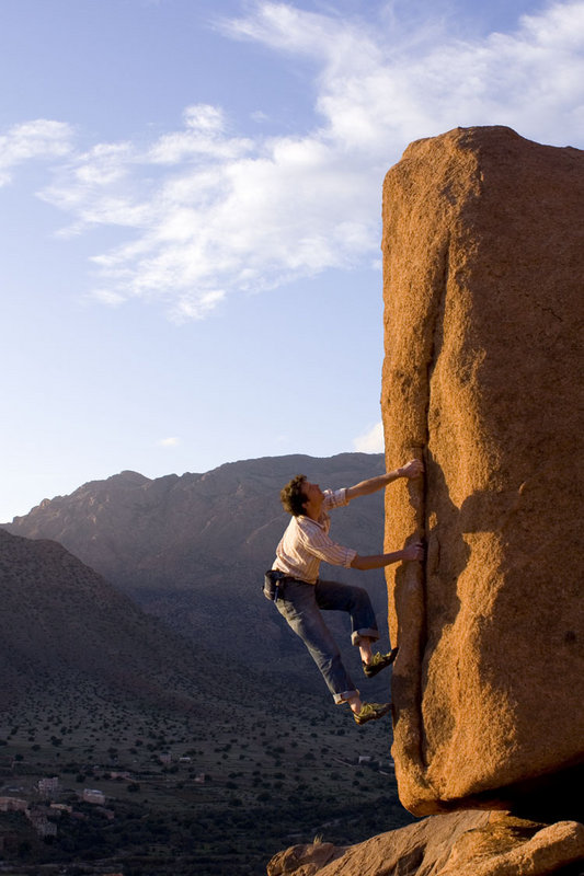 Jack Geldard enjoying evening light on one of the countless virgin boulders surrounding Tafroute, 100 kb