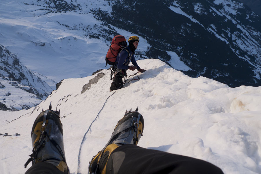 Jack Geldard's Spantiks poking over the edge of Death Bivvy, Eiger North Face., 117 kb