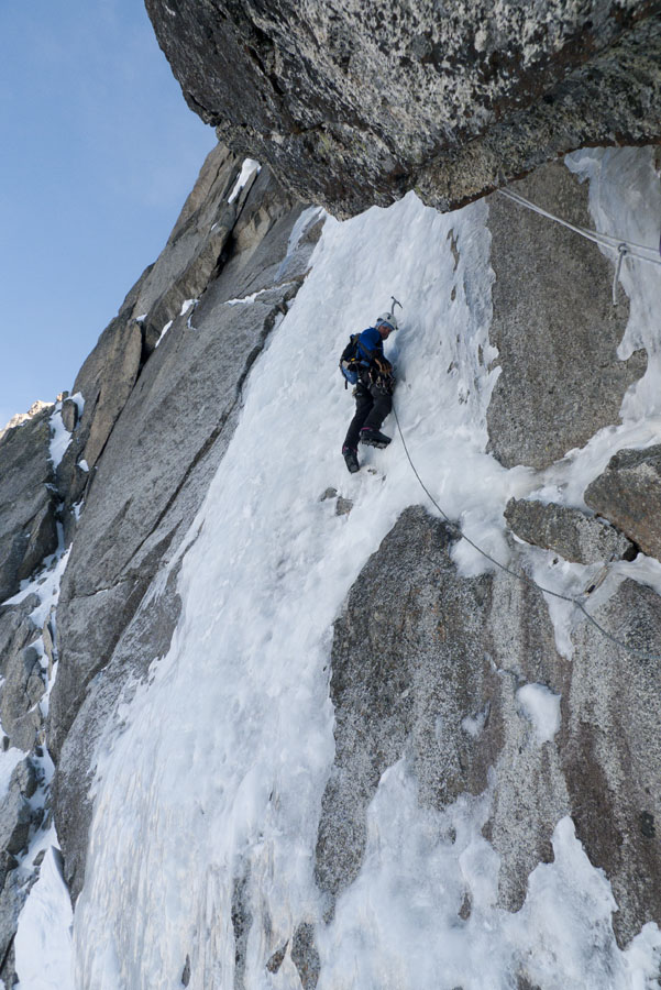 Matt Perrier climbing the crux ice pitch of Fil a Plomb in good conditions., 162 kb