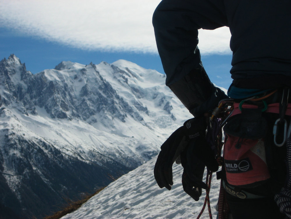 Handy - the Summitstretch gloves clipped within easy reach on Georgie's harness, 120 kb