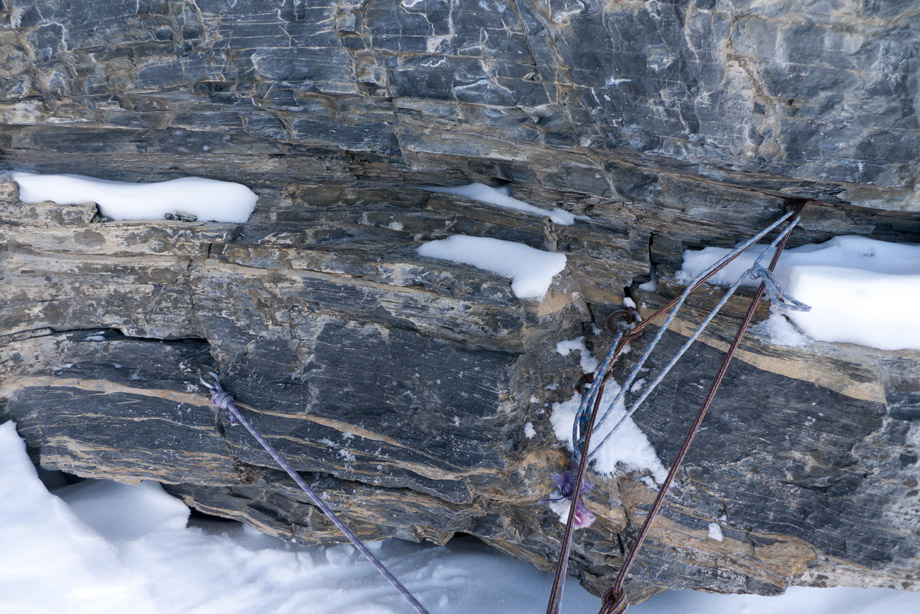 A typical belay on the Eiger North Face - Insitu old pegs litter the route, but other protection is scarce., 230 kb
