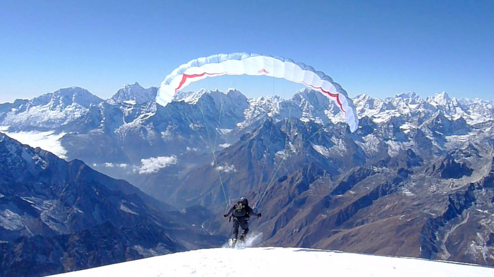 Stuart Holmes launching from Ama Dablam in November 2009 with a speedglider (mini paraglider), 106 kb