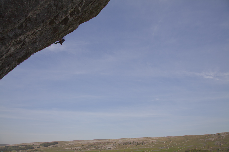 Chris Savage high above the Yorkshire Dales, on True North, Kilnsey North Buttress (F8c), 152 kb