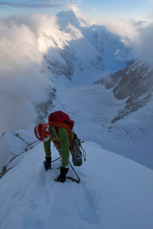Will Sim on the Cowboy arete, sun setting in the background., 73 kb