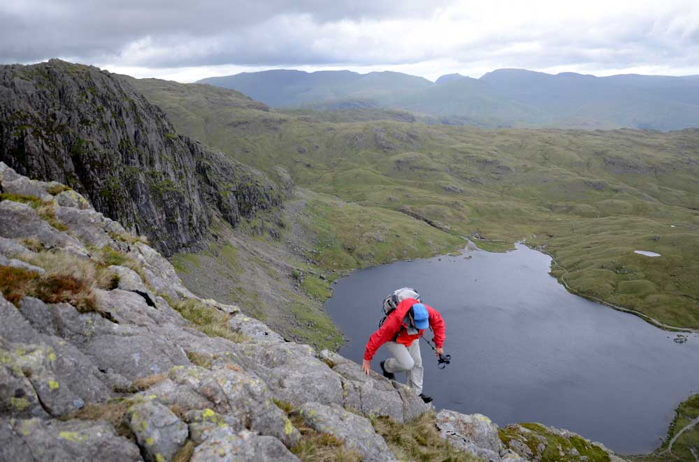 Cameron McNeish scrambling above Stickle Tarn wearing the Mountain Hardwear DryQ Elite Drystein Jacket, 69 kb