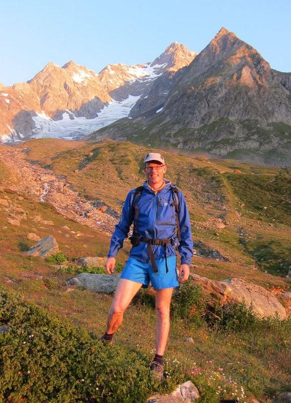 Jon Morgan at the Refugio Elisabetta, 2150m with the Aiguille des Glaciers behind, 170 kb