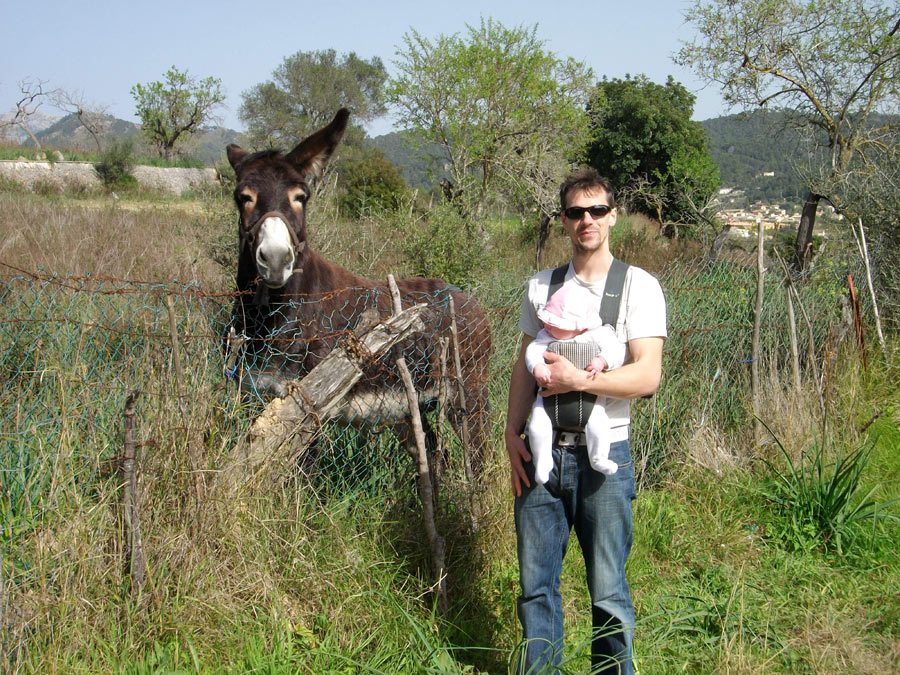 Chris Savage on holiday with his baby daughter Ciara (and a friendly mule!), 227 kb
