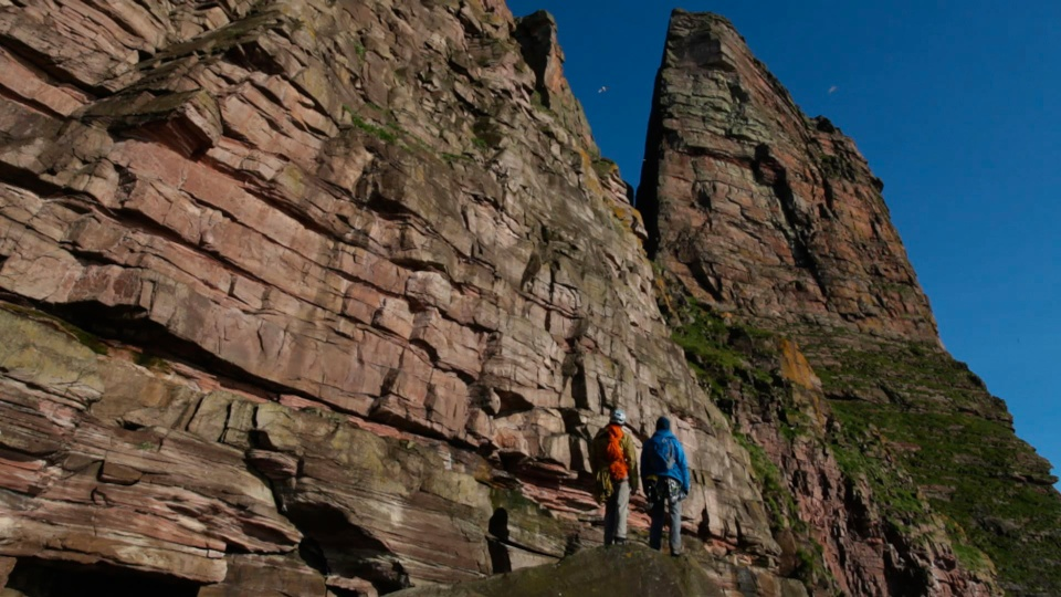 Dave MacLeod and Andy Turner looking up at the hulking sandstone epic of St John's Head, 201 kb
