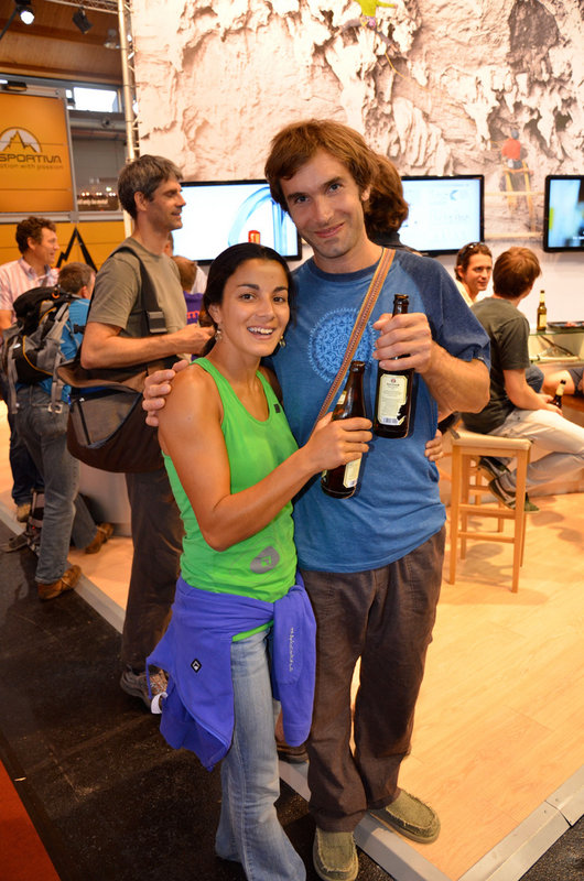 Daila Ojeda and Chris Sharma enjoying a beer on Saturday evening on the Petzl stand at the Germany Trade show, 132 kb
