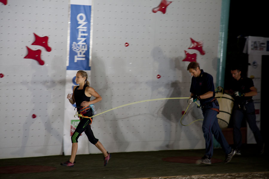 Running to the start of competition routes isn't uncommon, here young Sasha DiGiulian makes her belayer work hard to keep up, 78 kb
