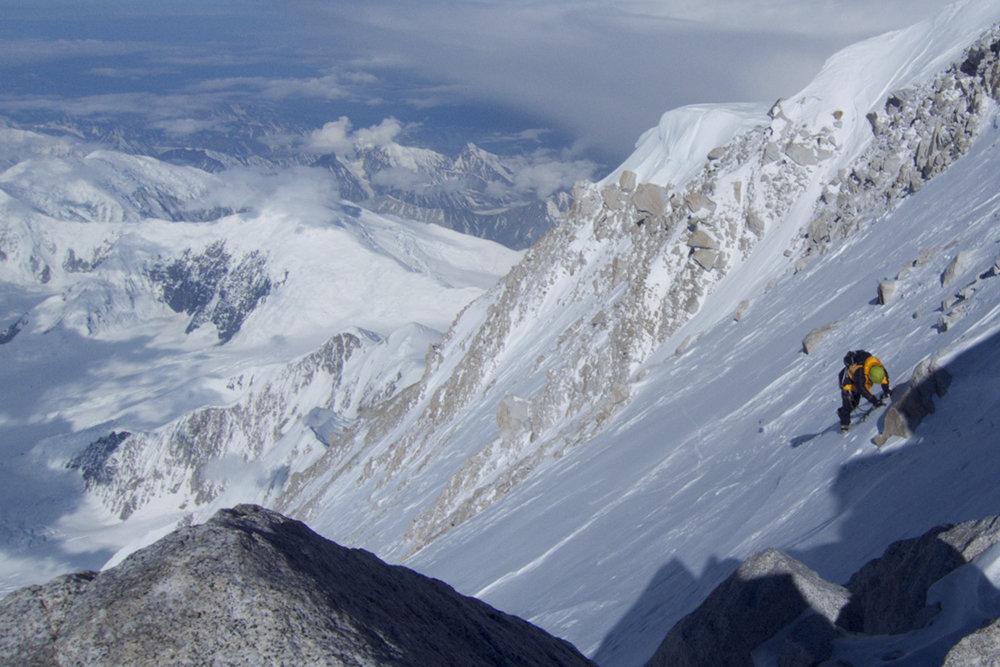 The final slog up the Cassin ridge in a Hispar down jacket. © Will Sim, 156 kb