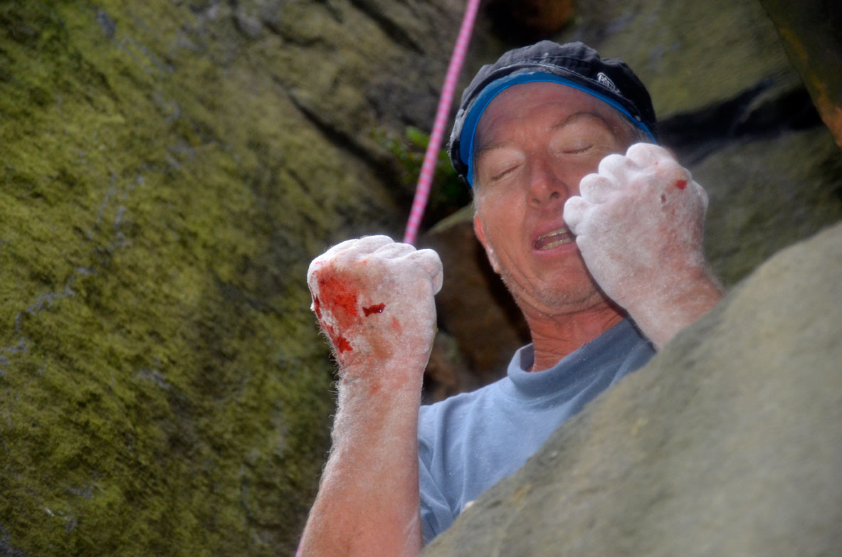 Russ Walling at the top of Forked Lightning Crack in his Petzl Ultimate Cap, 133 kb