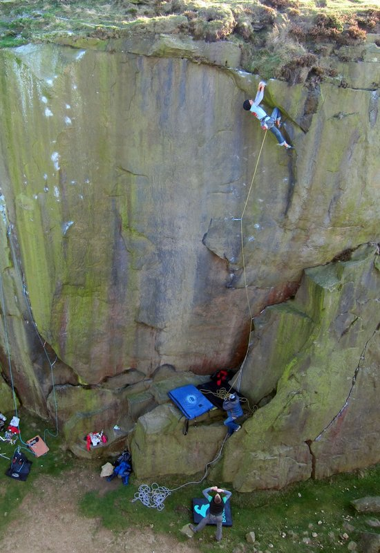 Naomi Buys pulling through the final steep section of Snap Decision (E7 6c) Ilkley Quarry, 99 kb