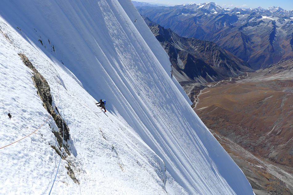 Dave Turnbull climbing the summit ice slopes on the first ascent of Gojung, 148 kb