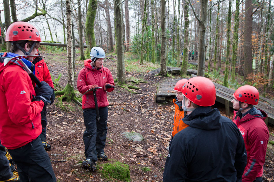 Helen teaching crampon use on the wooden facility outside PyB, 208 kb