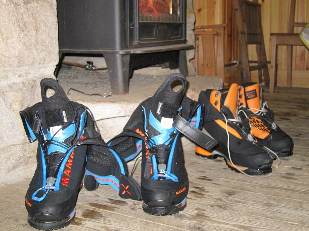 Nordwand boots drying out showing the laces and Velcro inner boot system., 149 kb