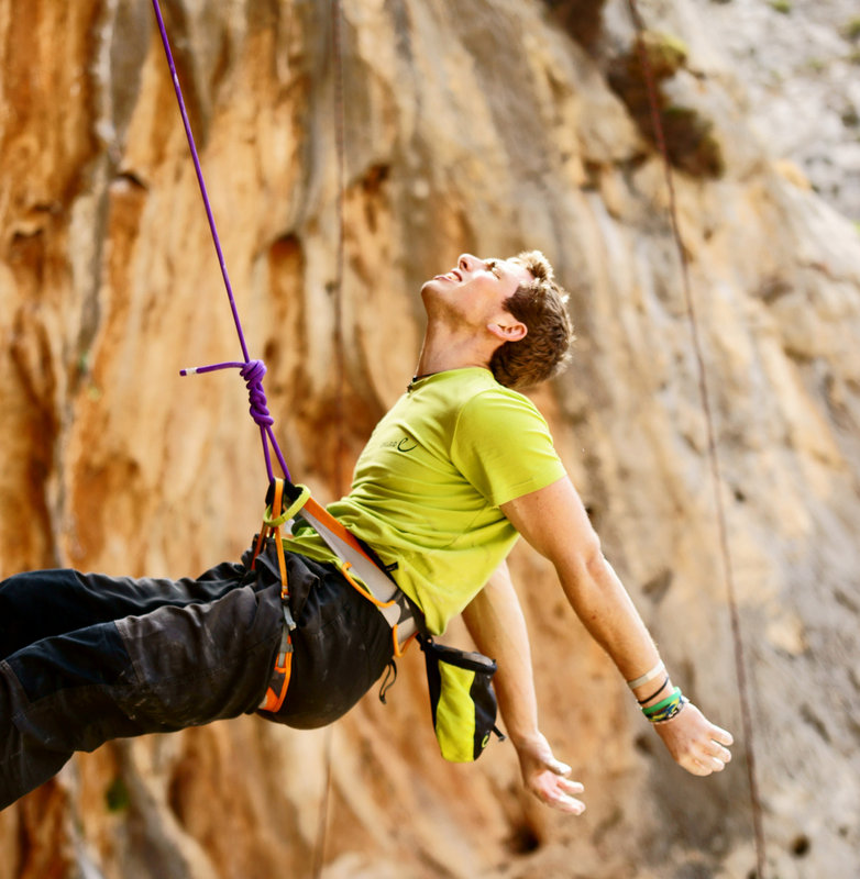 Robbie Phillips slumped on the rope after failing on a route in Kalymnos, 124 kb