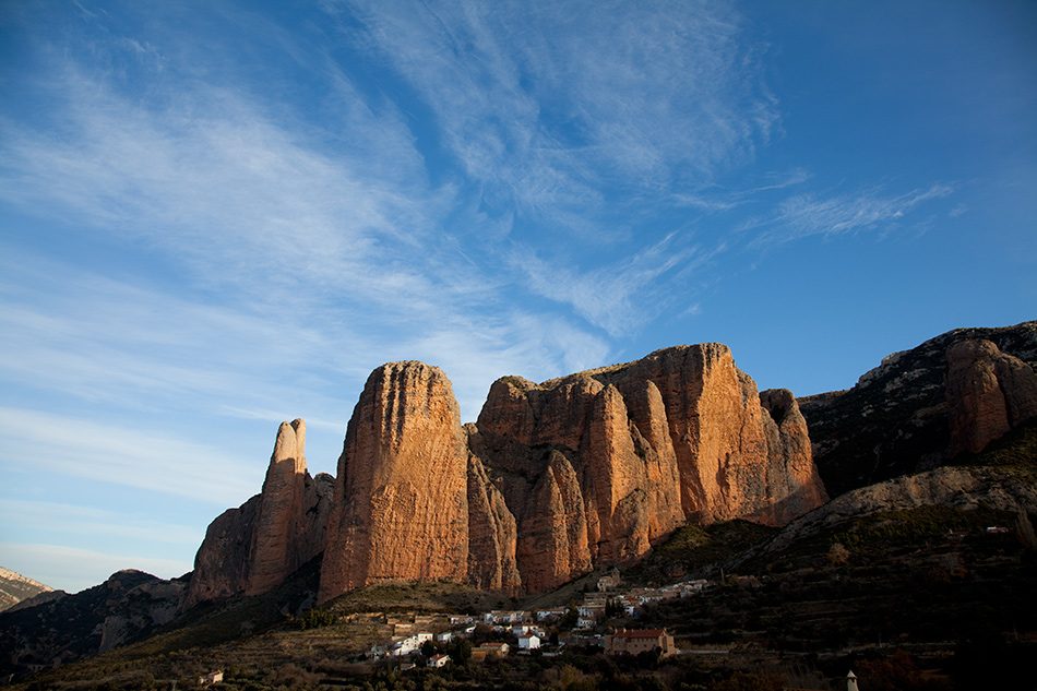 Riglos, Spain. The classic route of Fiesta de los Biceps takes the left side of the steep face on the right., 221 kb