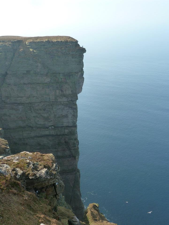 Simon Brentford looking small on top of St John's Head before his jump, 71 kb