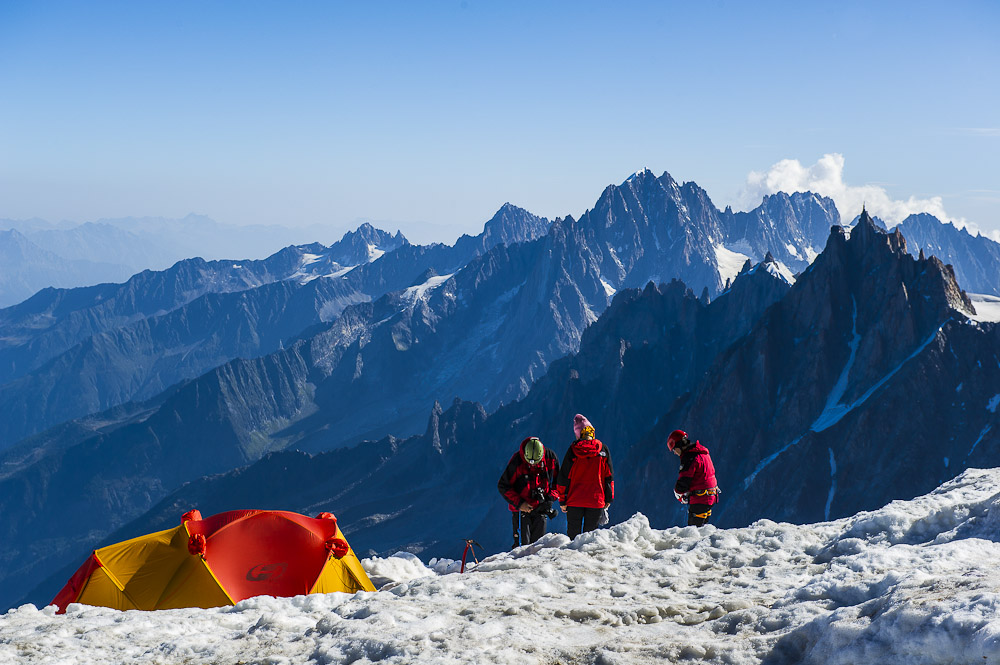 A group of alpine climbers check their gear before heading towards the summit of Mont Blanc., 175 kb