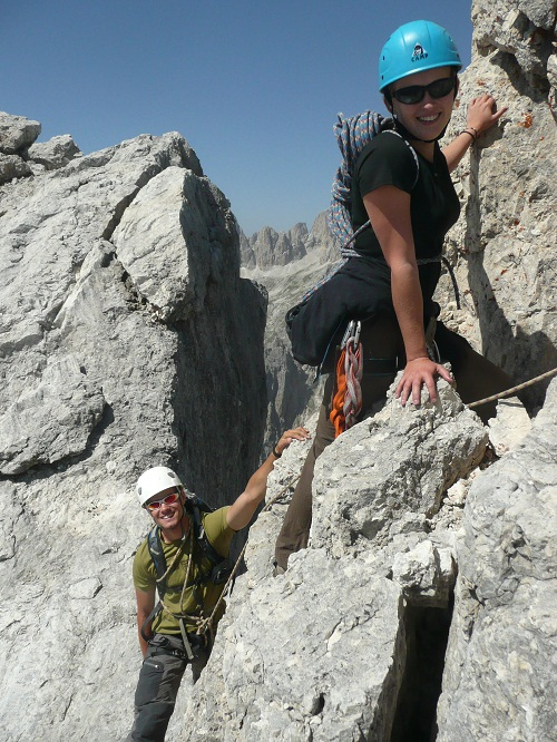 Anna and James Coates scrambling over the final rocks to the summit of the Sasso d'Ortiga., 167 kb