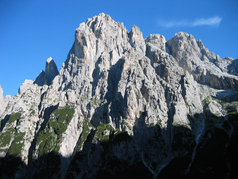 The Pala del Rifugio seen from across the valley.  The NW Ridge is the left hand skyline of the main peak., 130 kb