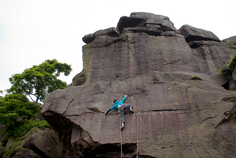 Stretching for the hold on Eraser Slab at Earl Crag, 122 kb