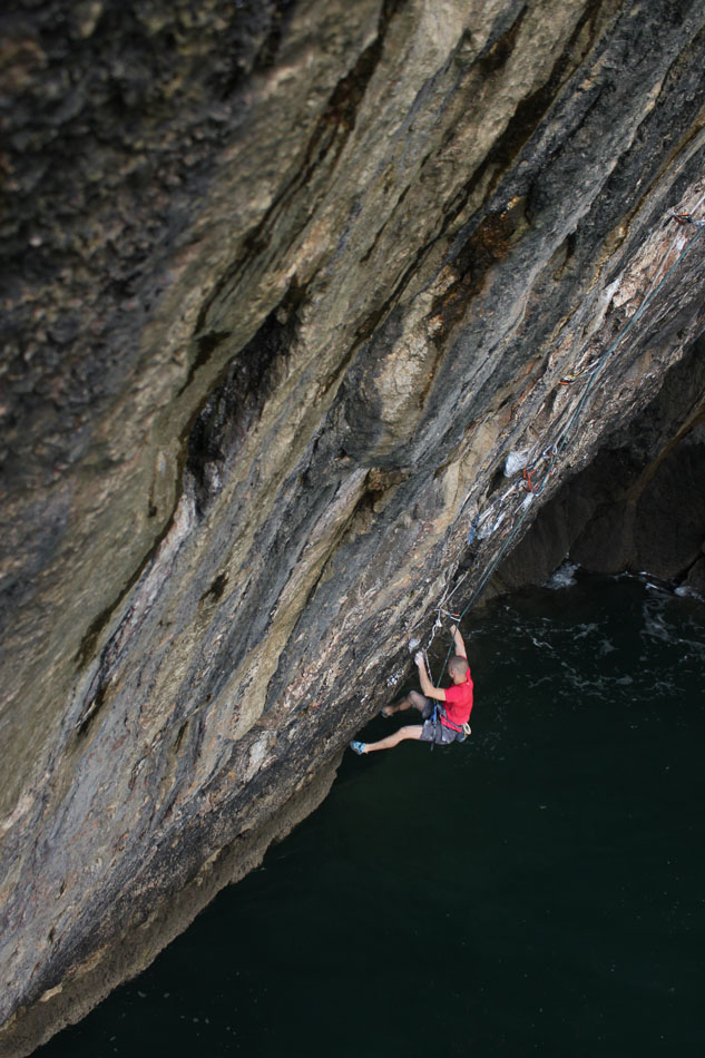 Neil Gresham checking out 'Olympiad' 8b on abseil. One of the hardest routes he thinks he has ever climbed., 154 kb
