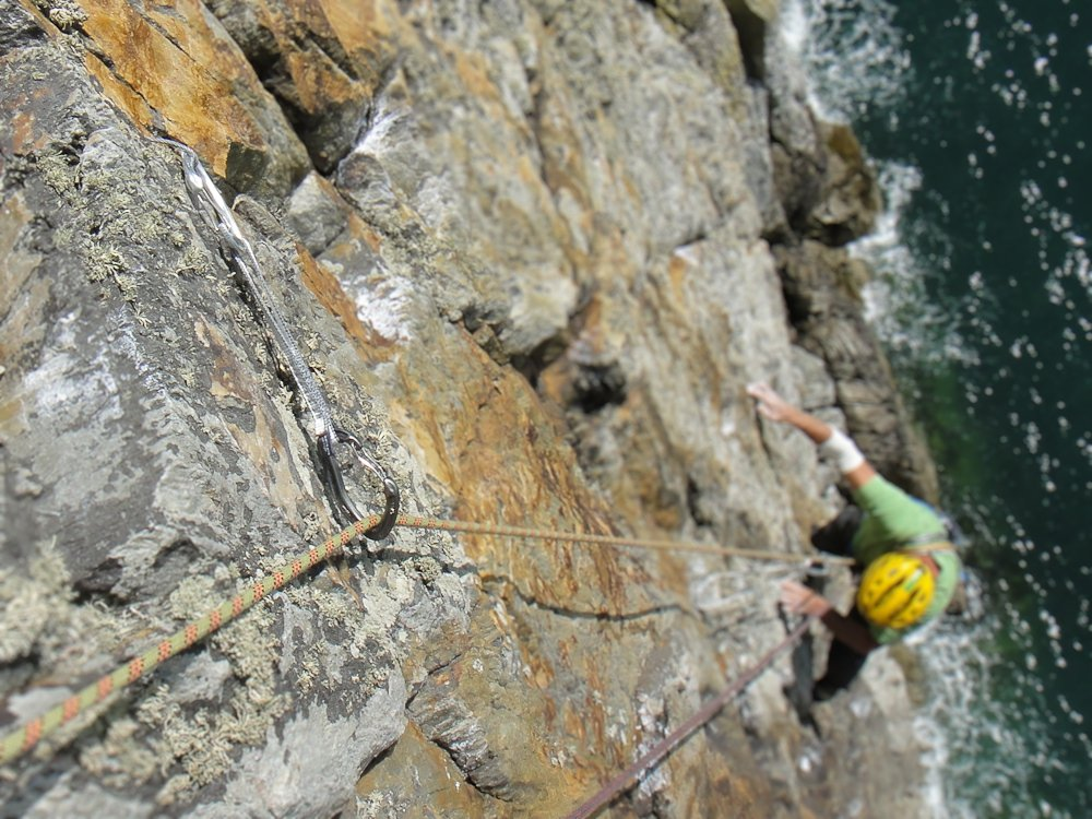 Pete Johnson following Eraserhead (E5, Gogarth Main Cliff) showing Alpha Trad in use during testing, 171 kb