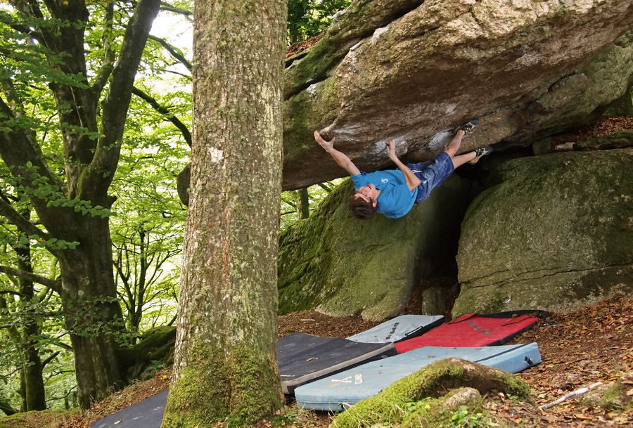 James Squire reaching for the lip on Jungle V.I.P (font 8a) at Burrator Reservoir, Dartmoor., 223 kb