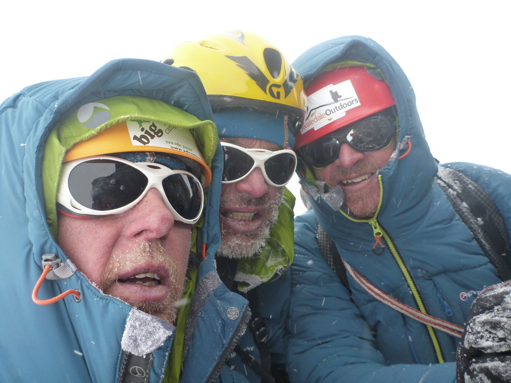 Dunglung Khangri SW Face. Summit in a whiteout. Climbers L-R Simon Yearsley, Malcolm Bass, Paul Figg. Photo Simon Yearsley, 137 kb