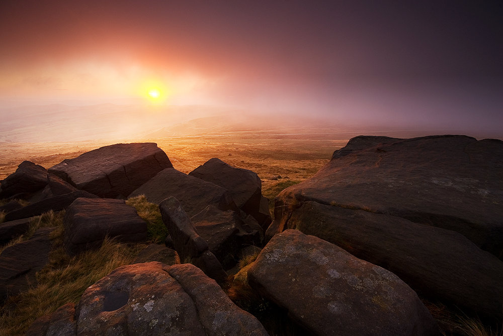 A gap in hill cloud at sunrise, allows the sun to light up the mist around West Nab, Meltham Moor., 132 kb