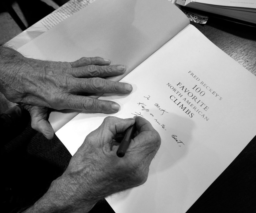 Fred Beckey signing a copy of his magnum opus, Fred Beckey's 100 Favorite North American Climbs., 77 kb