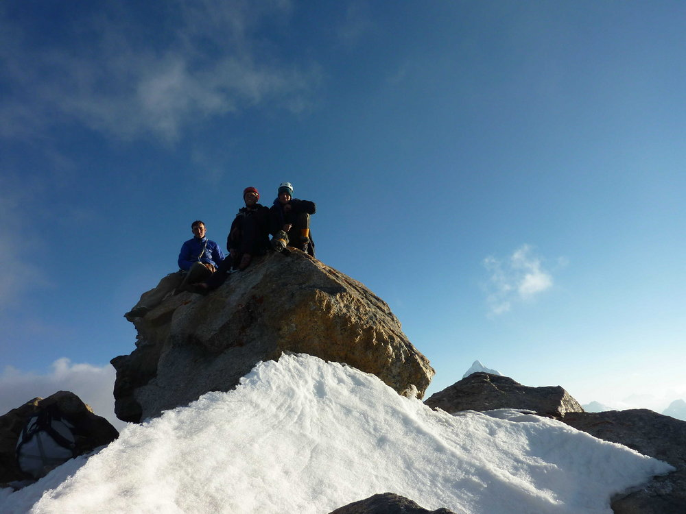 The summit of Pik 4810, from left to right: Ian Faulkner, Tom Codrington and Ian Cooper., 105 kb