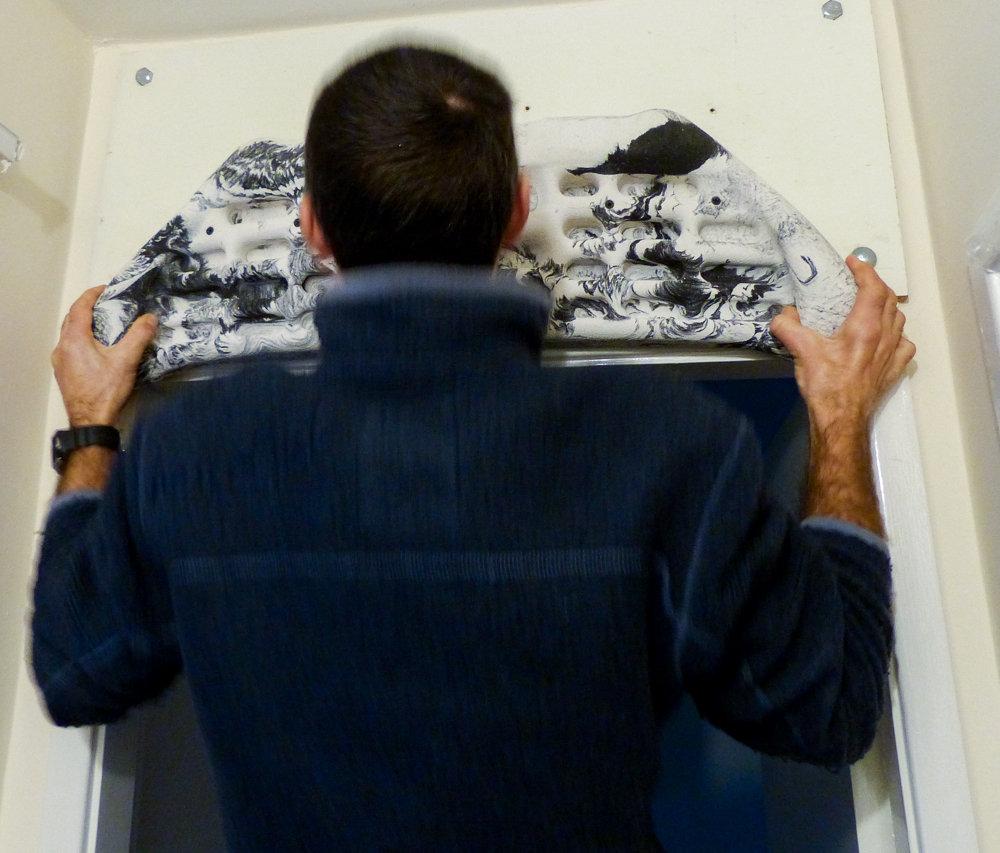 Paul Platt (AMI Chair) tries out the pinch grips, 155 kb