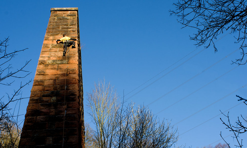 It doesn't get much more urban than this! Climbing into the sun on the old viaduct towers of Blantyre, Arrol's Arete (6b), 175 kb