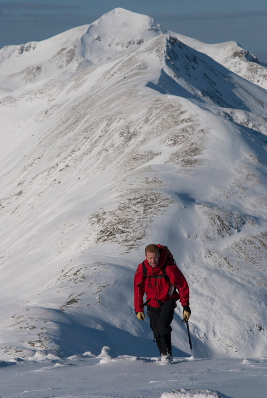 Brian Wills in the Mamores - note the snow blown from the left and deposited on the right, 88 kb