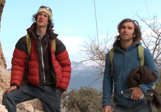 Adam Ondra and Chris Sharma beneath the Dura Dura project, 45 kb