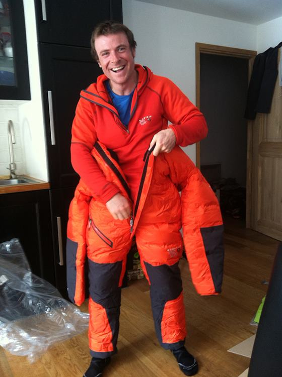 Jon Griffith at home, packing for and excited to go to Everest prior to his trip., 52 kb