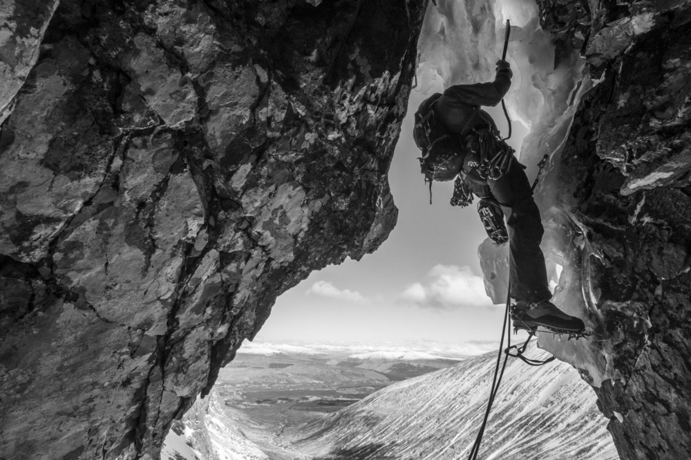 Mike Pescod pulls out of the cave on Ben Nevis�s Minus Three Gully in a prototype of the winter shell jacket., 158 kb