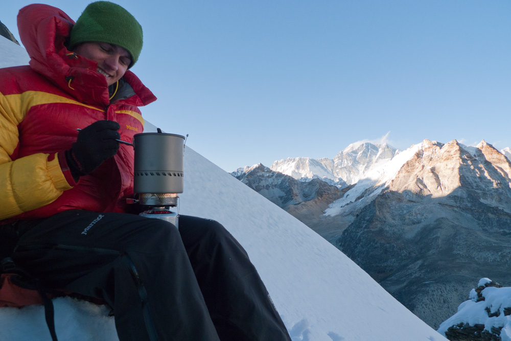 Rob on the bivvy as nightfall approaches. Everest in the background., 158 kb