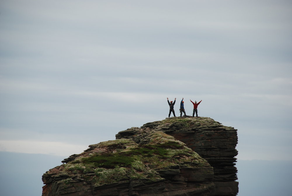 The Blind Man of Hoy - the triumphant three celebrate on the summit, 61 kb