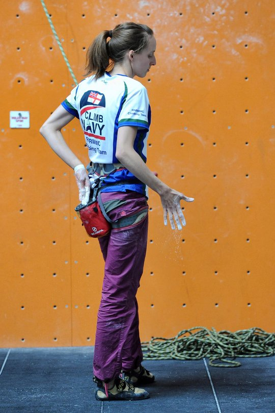 Lucy Matthews preparing herself for her lead climb to victory in the womens' category, 113 kb