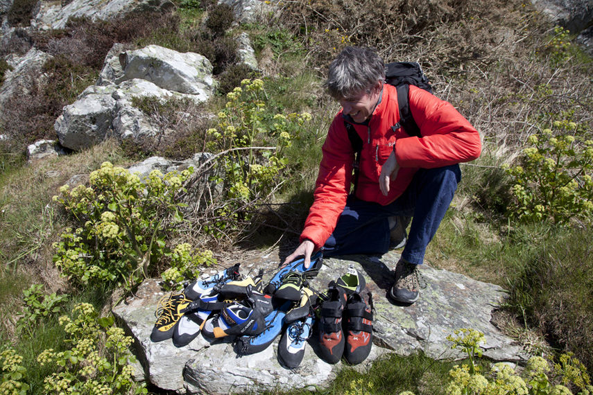 Alan James at Holyhead Mountain, with a big pile of shoes on test, 217 kb