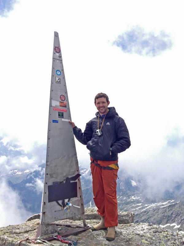 Guy on the summit of the Piz Badile, 3305,, 86 kb