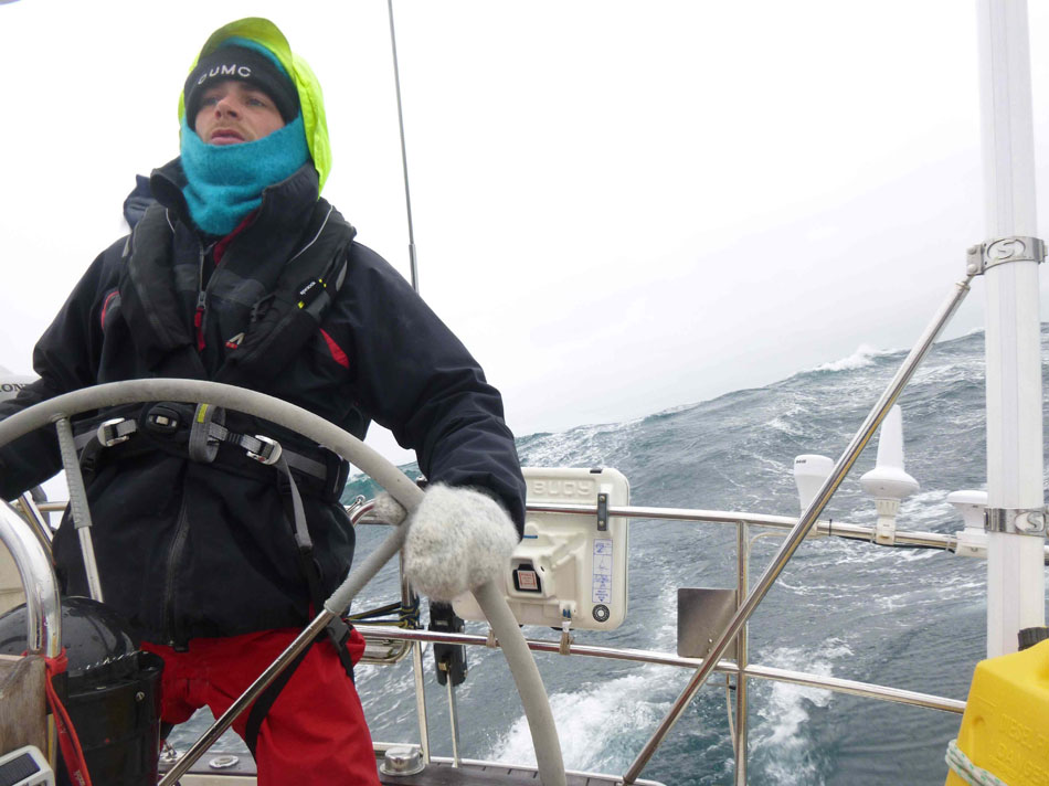 Peter steering the boat during a gale!, 125 kb