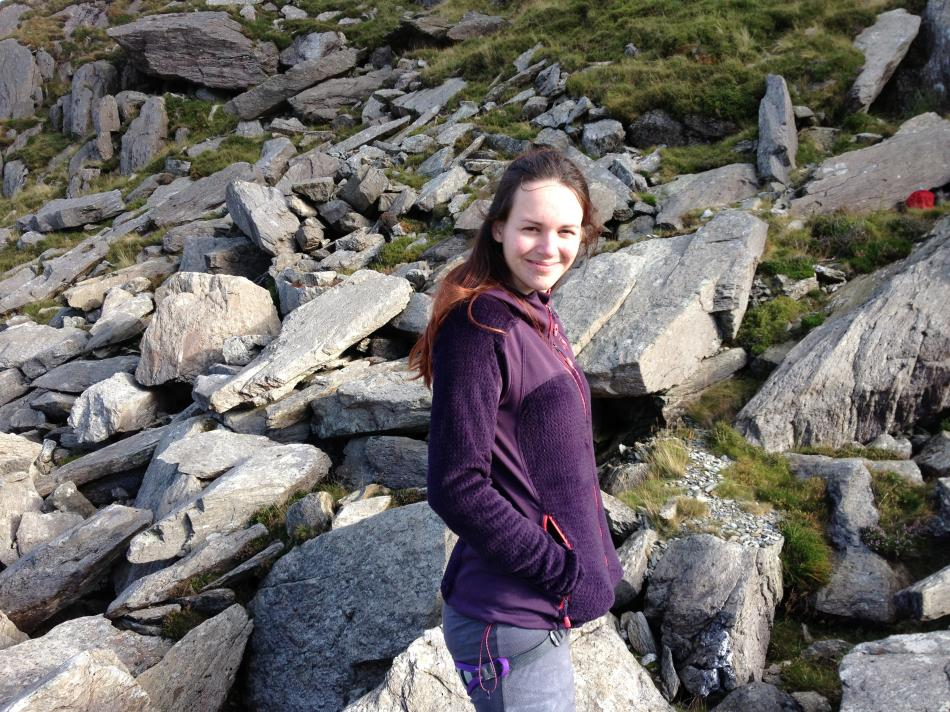 Emma Twyford chilling before her ascent of Rare Lichen, 158 kb
