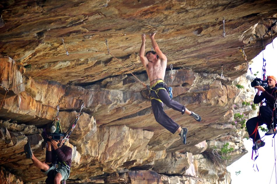 Alex hanging from a mono finger jam on his first ascent of Green Peace 31 (8a+) at The Mine, 123 kb